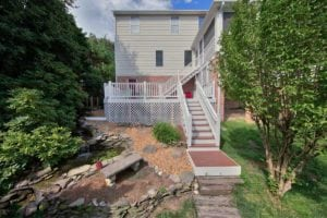 Custom, Wooden Deck Leading to a Garden and Pond in Hampton Roads, VA