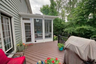 Sunroom with Attached Wooden Deck and Outdoor Grill in Charlottesville, VA