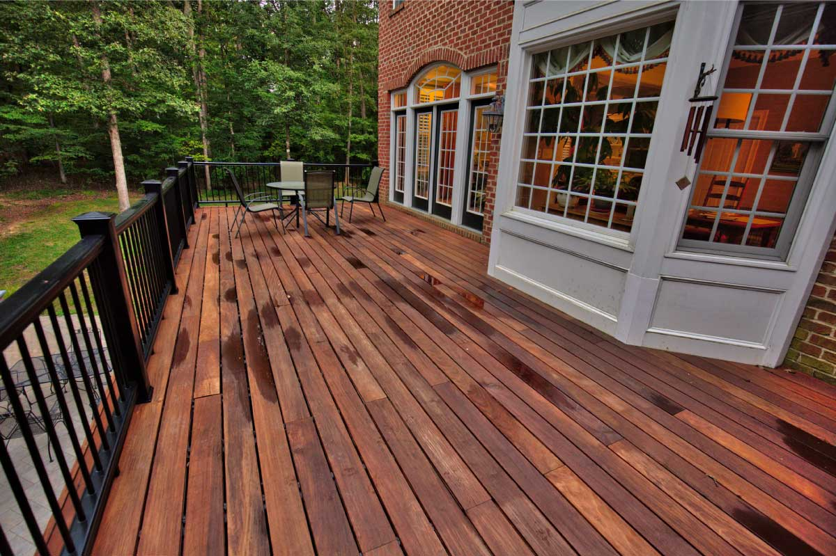 Brick House with a Wooden Deck After Rain in Williamsburg VA
