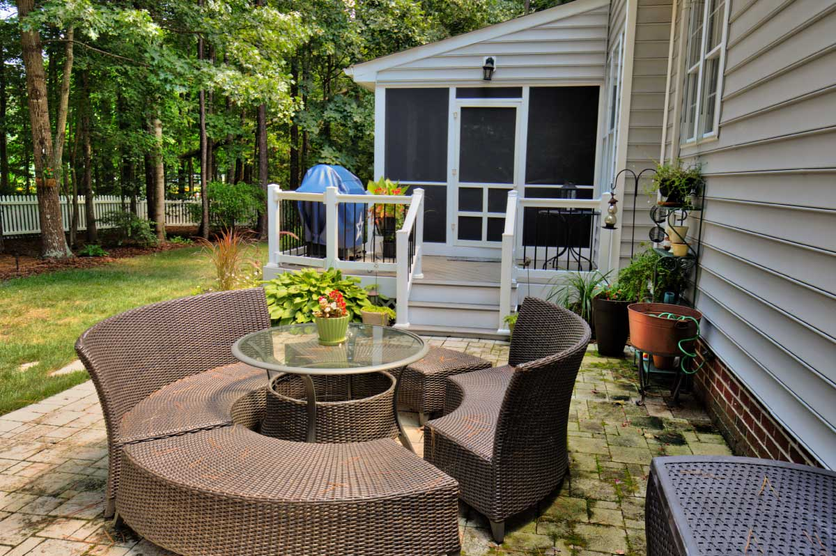 Outdoor Furniture on Stone Patio by Deck Creations in Richmond VA