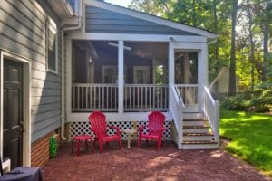 Custom Screened Porch with Red Outdoor Furniture in Charlottesville VA
