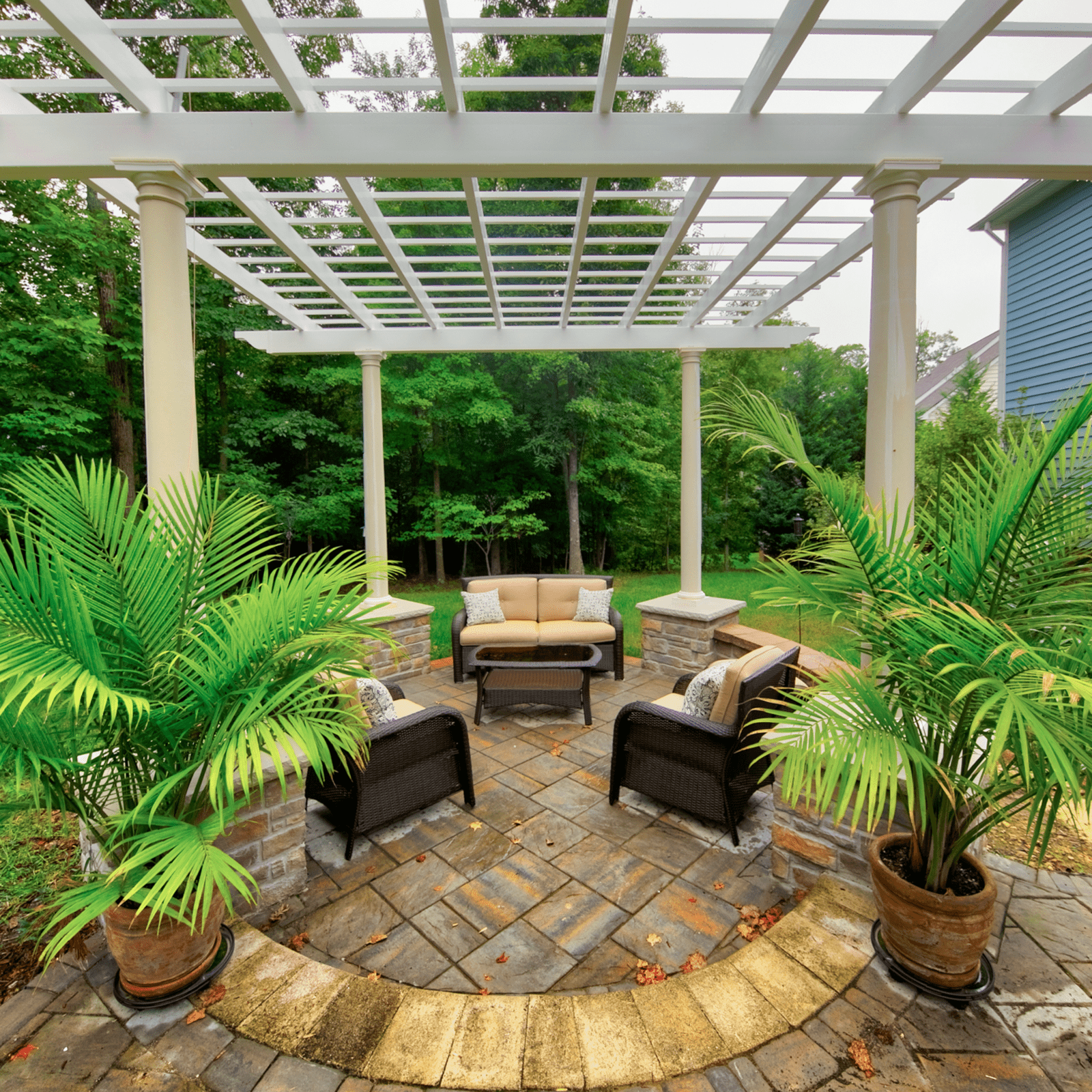 Patio and Furniture Under a White Pergola in Hampton Roads Patio Builders | Norfolk, Hampton and Virginia Beach
