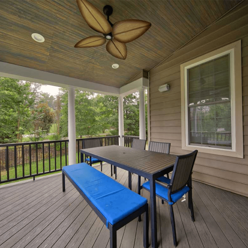 Covered Deck with Ceiling Fan and Table in Richmond, VA | Deck Creations