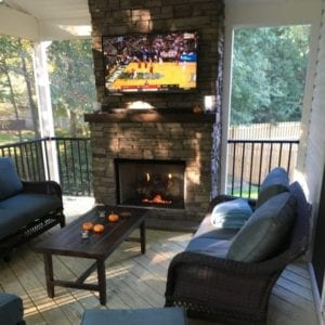 Screened-in Porch with a Fireplace, Mounted TV and Furniture in Richmond, VA