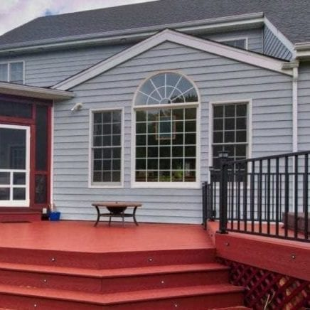 Blue Colored Vinyl Siding and Red Deck by Deck Creations | Virginia Beach, VA