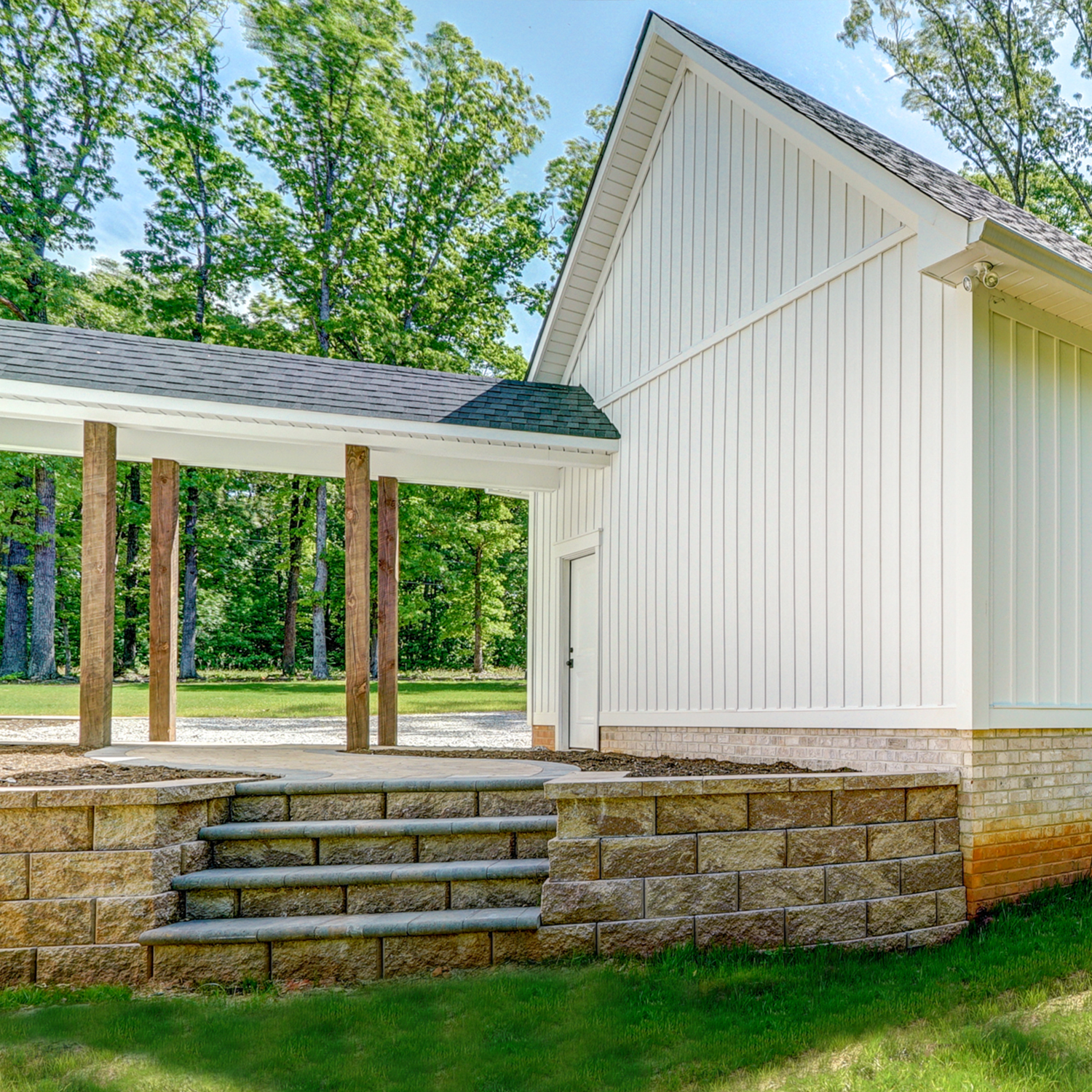 Covered, Stone Walkway (Colonnade) with White Siding in Richmond, VA