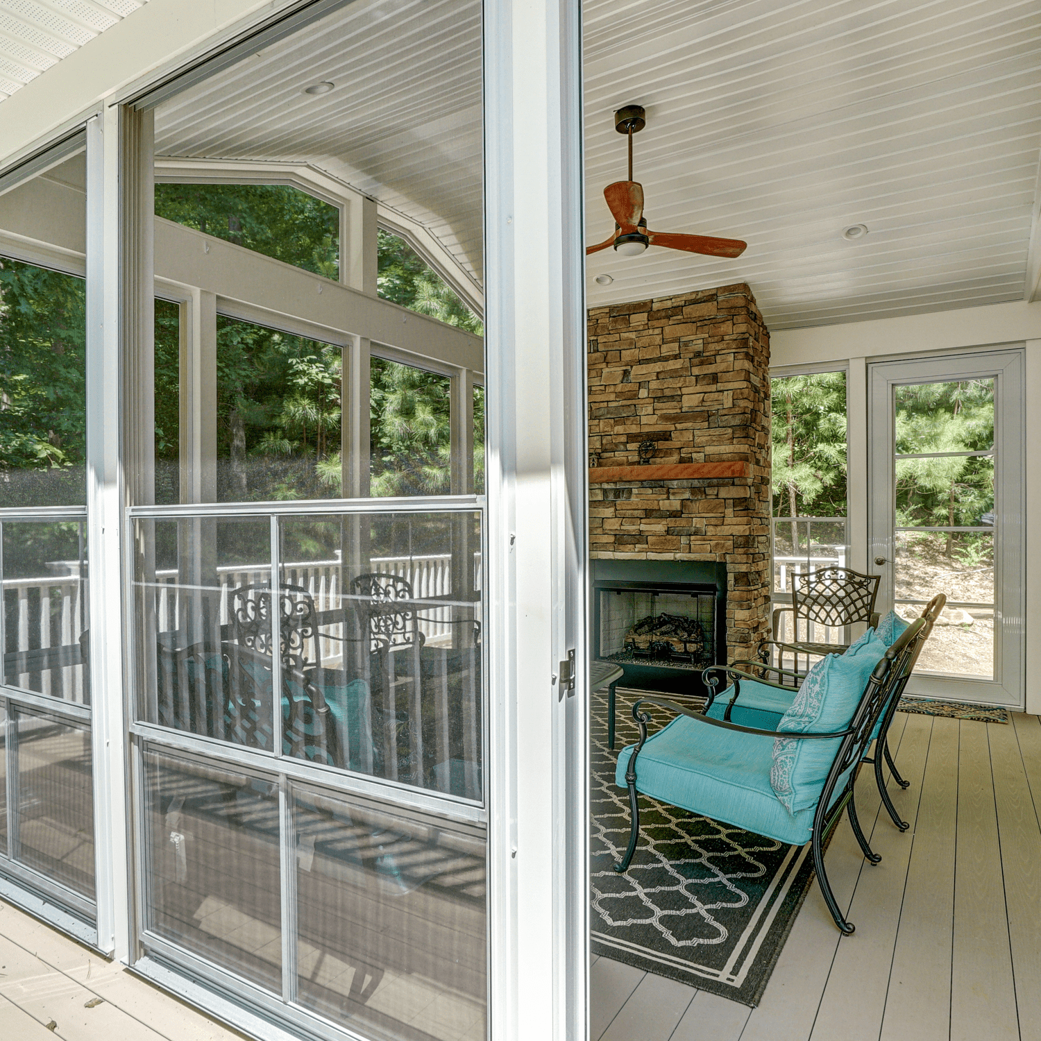 Looking into a Screened-In Porch with a Fireplace and Ceiling Fan in Charlottesville